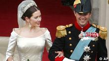 Denmark's Crown Prince Frederik and his new wife Crown Princess Mary, leave Our Lady's Church following their wedding ceremony in Copenhagen, Friday May 14, 2004. Royals from nearly every monarchy in Europe, prime ministers, nobles and diplomats witnessed the commoner, Mary Donaldson from Hobart, exchange traditional Danish vows with Crown Prince Frederik, the heir to Denmark's 1,000-year-old throne. (AP Photo/John McConnico)
