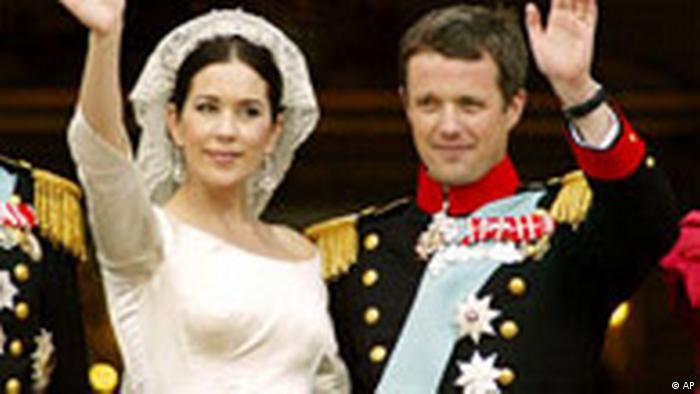 Princess Mary and Crown Prince Frederik waving from the Amalienborg Palace balcony after their wedding ceremony