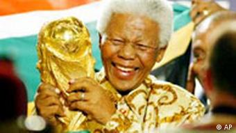 Nelson Mandela holds the World Cup trophy