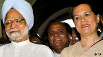 Congress Party President Sonia Gandhi, right, and prime minister in waiting Manmohan Singh, left, pose for the media after Singh was elected as parliamentary chief, outside the Parliament building in New Delhi in May, 2004Photo:Manish Swarup/AP