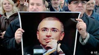 Demonstrator holding Khodorkowsky poster