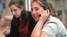 Teenager talks on cell phone, photo