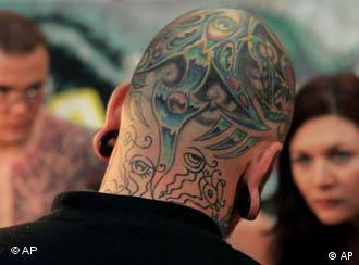 Man with tattooed head at Swiss tattoo expo