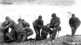 Soldiers At The Normandy Coast