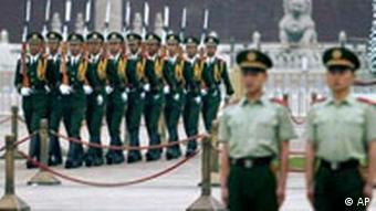 Chinese paramilitary police march onto Beijing's Tiananmen Square to perform the daily flag raising ceremony