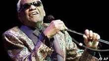 US blues legend Ray Charles performs in Zurich, Switzerland, Nov. 19, 2001. Ray Charles died at the age of 73 on Thursday, June 10, 2004. (AP Photo/Keystone/Franco Greco)