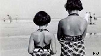 Anne Frank (left) stands with her sister Margot on the beach in the Netherlands in July 1938