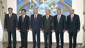 From left: Tajikistan's President Emomali Rakhmonov, Chinese President Hu Jintao, Uzbekistan's President Islam Karimov, Russian President Vladimir Putin, Kazakhstan's President Nursultan Nazarbayev and Kyrgyz President Askar Akayev pose for press in Tashkent, Uzbekistan, Thursday, June 17, 2004. The presidents of China, Russia and four Central Asian nations fortified their security alliance Thursday with a meeting to discuss regional threats and inaugurate an anti-terrorism center in Uzbekistan. (AP Photo/ITAR-TASS, Presidential Press Service )