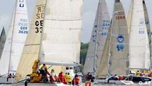 Segler steuern am Samstag, 19. Juni 2004, ihre Boote zur Aal-Regatta von Kiel aus mit Ziel Eckernfoerde. Dieses Rennen ist der Auftakt zur diesjaehrigen, 122. Kieler Woche, der Welt groesstes Segelereignis, an dem 5.000 Segler aus 50 Nationen teilnehmen. Bis zum Abschluss am 27. Juni erwarten die Veranstalter drei Millionen Besucher bei den Wettberben auf der Kieler Foerde und bei den parallel stattfindenden Musik- und Unterhaltungsprogrammen fuer Gross und Klein. (AP Photo/Heribert Proepper) --- Sailors sail their boats during the so-called Eel Regatta through the water of the Kiel Bay off Kiel, northern Germany, on Saturday, June 19, 2004. This boat race marks the start of the Kiel Week, the world's biggest sailing event in which 5000 sailors from 50 nations participate. An estimated three million visitors are expected until the end of June 27 to watch the sailing competitions and to enjoy the entertainment offerings. (AP Photo/Heribert Proepper)