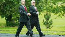 US President George W. Bush with Irish Prime Minister Bertie Ahern, right, as they take a stroll at Dromoland Castle in Co. Clare, western Ireland, Friday June 25, 2004 at the start of the European Union / US summit meeting. The EU/US meeting runs until Saturday. (AP Photo / Maxwell / Pool)
