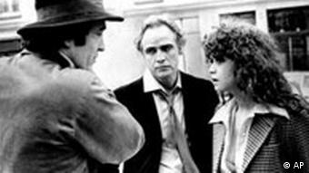 ** FILE ** Director Bernardo Bertolucci, left, discusses a scene from Last Tango in Paris with leading actor Marlon Brando and actress Maria Schneider during location shooting in Paris in this undated black and white photo. Brando, who revolutionized American acting with his Method performances in Streetcar Named Desire and On the Waterfront and went on to create the iconic characterization of Don Vito Corleone in The Godfather, has died, his lawyer said Friday, July 2, 2004. He was 80. (AP Photo)