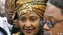 Winnie Madikizela-Mandela, the former wife of Nelson Mandela, center, leaves the high court in Pretoria, South Africa, Monday, July 5, 2004, after winning her appeal against a four-year jail term for alleged theft and fraud. (AP Photo/Themba Hadebe)