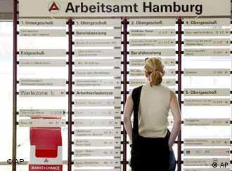 A woman looks at an information board at an employment agency