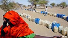 A Sudanese refugee waits for water to be distrubuted by aid organisastions, Thursday, July 8, 2004 in Bahai on the Chad, Sudan border.An estimated 1 million Sudanese have been displaced during the conflict with Arab militias with at least 200,000 fleeing into neighbouring Chad.(AP Photo/Karel Prinsloo)