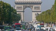 Traffic moves on the Champs-Elysees avenue, coming from and heading towards the Arc de Triomphe, Friday, Sept. 19, 2003 in Paris. France is considering a London-style vehicle congestion charge for Paris in an effort to reduce choking pollution which has pushed the capital close to emergency traffic restrictions, Ecology Minister Roselyne Bachelot said Friday. (AP Photo/Michel Euler)