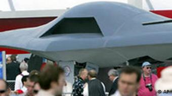 The Northrop Grumman X-47B part of the joint unmanned combat system pulling in the crowds whilst on static display at Farnborough Airfield, England, Wednesday July 21, 2004. This week the airfield hosts the bi-annual Farnborough Airshow which attracts visitors and exhibitors from around the world. (AP Photo/Dave Caulkin)