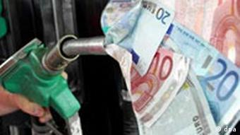A fuel pump with euros shooting out of it is pointed at the viewer