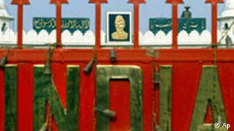 A Pakistani soldier, top right, stands guard, overlooking to the closed border gate to India, in red, at Wagah, the joint border post of India and Pakistan, Saturday, Aug. 14, 2004. Pakistan on Saturday marked its 57th Independence Day from British rule. In center of photo is Mohammed Ali Jinnah, founder of Pakistan and its first president. (AP Photo/Aman Sharma)