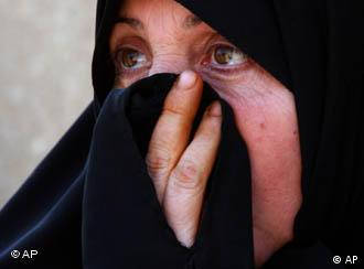 A Shiite woman holding her hand over her mouth