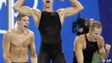 South African swimmers react after winning the 4x100m freestyle relay at the 2004 Olympic Games Sunday, Aug. 15, 2004 in Athens, Greece. (AP Photo/Mark Baker)