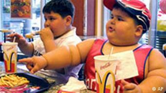 Obese children enjoy a meal at a McDonald's restaurant
