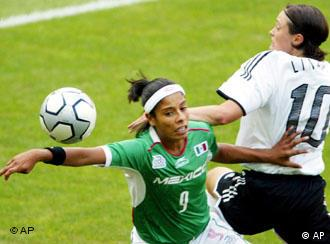 Germany's Renate Lingor, right, goes for the ball against Maribel Dominguez of Mexico in the womens first round Group F Olympic soccer match at the Karaiskaki stadium in Athens, Tuesday, Aug. 17, 2004. (AP Photo/Diether Endlicher)