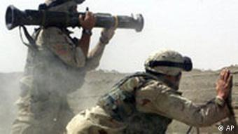 U.S. Army soldiers fire an anti-tank rocket at an insurgent position near the cemetery in Najaf, Iraq, Wednesday, Aug. 18, 2004. Sporadic but heavy fighting continued Wednesday. (AP Photo/Jim MacMillan)