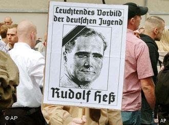Hess supporters with a poster that shows his picture in Wunsiedel in 2004