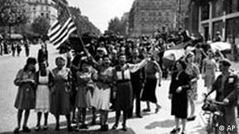 French people waving the American flag after liberation