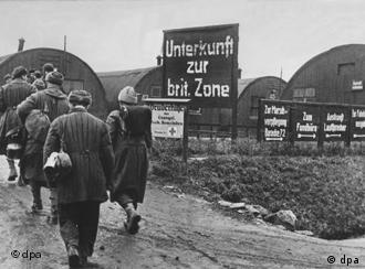 Balck and white photo of refugees from World War II entering the British Zone.