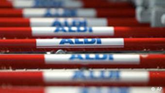 Line of supermarket trolleys with Aldi written on handle
