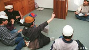 Children learn the Koran at lessons in a mosque in Berlin