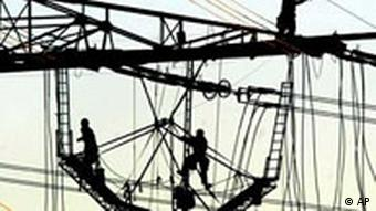 Workers repairing high voltage overland electricty cables