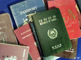 A pile of passports from several countries