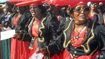 Herero women attend a gathering in Okokarara, Namibia