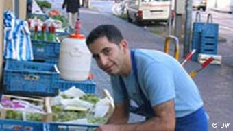 An ethnic Turk working at a fruit stand in Cologne