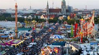 Munich street lined with carnival rides and beer tents