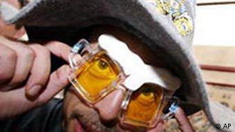A man with beer mug glasses celebrates Oktoberfest in Munich