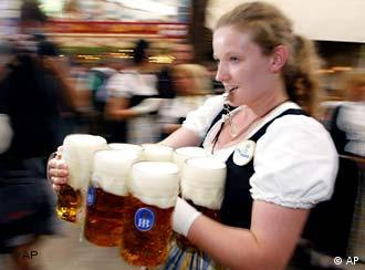 Woman carries large beer glasses at Oktoberfest