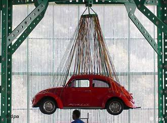 VW Bug suspended by cables