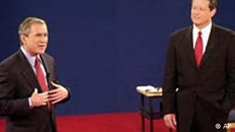 Republican presidential candidate Texas Gov. George W. Bush, left, speaks as Democratic presidential candidate Vice President Al Gore watches during their debate at Washington University in this St. Louis file photo from Oct. 17, 2000.