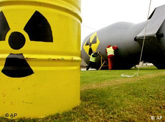A yellow can marked with the radiation sign and a large, inflateable bomb with the same sign