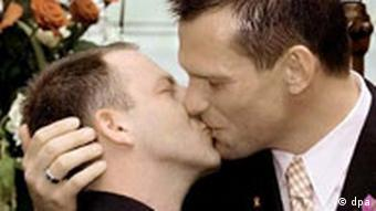 a gay couple kissing after their commitment ceremony