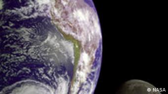 A side view of the earth and the moon from space