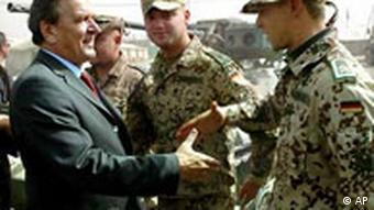 Gerhard Schroeder greets troops in Afghanistan