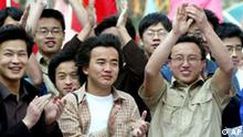 Students at Beijing's Northern Jiaotong University cheers as the end of their quarantine is announced at the University Thursday May 8, 2003. After spending two weeks in quarantine, about 375 students at the university in western Beijing were allowed to go free on Thursday. (AP Photo/Greg Baker)