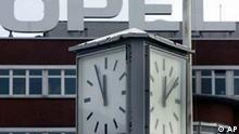 Eine Uhr vor dem Opel Werke in Bochum zeigt am Donnerstag, 14.Okt.2004 fuenf vor Zwoelf, waehrend die andere Uhr, rechts, bereits nach Zwoelf anzeigt. Die Opel-Mutter General Motors plant in Europa ein massives Sanierungsprogramm. Geplant ist die Senkung der Strukturkosten um jaehrlich 500 Millionen Euro bis 2006, wie am Donnerstag aus Unternehmenskreisen in Ruesselsheim verlautete. Dies bedinge den Abbau von 12.000 Arbeitsplaetzen in den kommenden zwei Jahren in den europaeischen Standorten. (AP Photo/Frank Augstein) --A watch in fdront of the Opel plant in Bochum, Germany, on Thursday, Oct 14, 2004. GM Europe announced Thursday that it plans to cut 12.000 jobs on the continent by the end of 2006. (AP Photo/Frank Augstein)