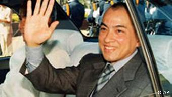 ** FILE ** Prince Norodom Sihamoni, one of King Norodom Sihanouk's sons, gestures during Independence Day celebrations in this Nov. 9, 2002 file photo in Phnom Penh, Cambodia. Sihamoni was named Cambodia's new king Thursday, Oct. 14, 2004, succeeding his father Norodom Sihanouk, who stunned the country last week by announcing his abdication because of ill health. (AP Photo/File)