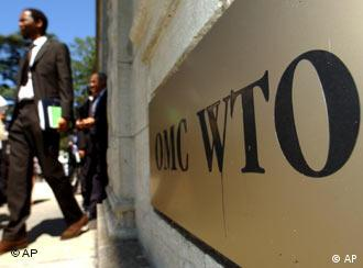 Unidentified delegates leave the WTO's headquarters