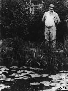 A 1923 black-and-white photo of Claude Monet at his garden in Giverny